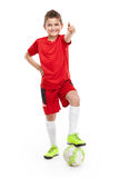 Standing young soccer player with football Royalty Free Stock Photo