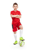 Standing young soccer player with football Royalty Free Stock Image