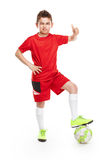 Standing young soccer player with football Royalty Free Stock Images