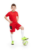 Standing young soccer player with football Stock Photos