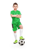Standing young soccer player with football Royalty Free Stock Photography