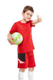 Standing young soccer player holding football Royalty Free Stock Image