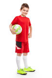 Standing young soccer player holding football Royalty Free Stock Photography