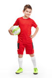 Standing young soccer player holding football Stock Photos