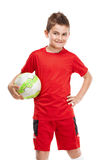 Standing young soccer player holding football Royalty Free Stock Photo
