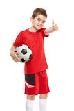 Standing young soccer player holding football Stock Image