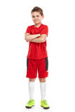 Standing young soccer player in sportswear Royalty Free Stock Image