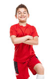 Standing young soccer player in sportswear Royalty Free Stock Photos