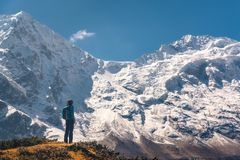 Standing young woman on the hill and looking on amazing Himalaya Royalty Free Stock Photos