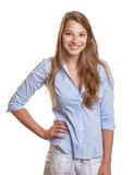 Standing young woman with long blond hair laughing Royalty Free Stock Photo
