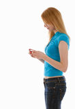 Standing young woman looking at something Stock Images