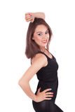 Standing young woman wearing a black t-shirt. White background Stock Photography