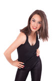 Standing young woman wearing a black t-shirt. White background Royalty Free Stock Photo