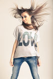 Standing young woman wearing jeans. And t-shirt with an inscription love Royalty Free Stock Photography