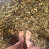Stando in un fiume Immagine Stock