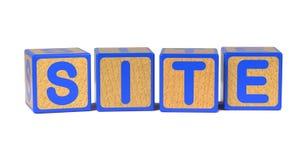 Standort - das Alphabet-Blöcke der farbige Kinder. Lizenzfreies Stockbild