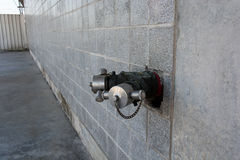 Standpipe on a City wall. Royalty Free Stock Images