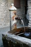 Standpipe. A sip of fresh mountain water Stock Images