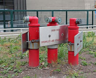 Standpipe And Sprinkler System. Three red standpipes and sprinkler system Royalty Free Stock Image