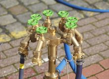 Water taps on a water hydrant. Standpipe with water taps on a water hydrant Stock Images
