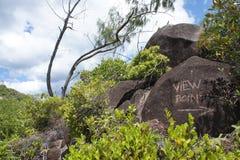 Standpunkt geschrieben in die Seychellen im Felsen Lizenzfreies Stockbild
