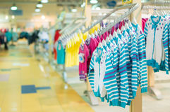 Stands with clothes in kids mall Stock Image