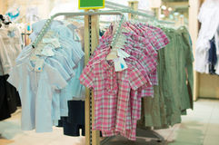 Stands with clothes in kids shop Royalty Free Stock Photos