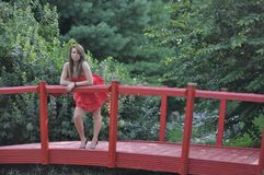She Stands Upon the Red Bridge Royalty Free Stock Photo