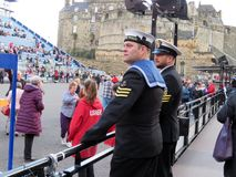 The Military Tattoo at Edinburgh. The stands slowly getting filled up in the evening for the 2017 Military Tattoo at Edinburgh, while two seamen in uniform stock photos