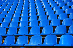 Stands at the stadium. Dark blue rows of seats on the stadium Royalty Free Stock Photography