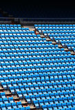 Stands of a stadium, with rows of seats Royalty Free Stock Photo