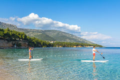 Standup paddle boarders at Zlatni Rat beach, Croatia Royalty Free Stock Images