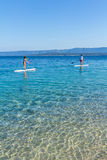 Standup paddle boarders at Zlatni Rat beach, Croatia Royalty Free Stock Photo