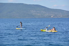 Standup paddleling Royalty Free Stock Images