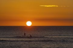 Standup Paddler on the oean on the island of Maui. Standup paddler at sunset on the island of Maui Royalty Free Stock Photography