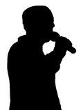 Standup singing. Silhouette of a man talking in a microphone Stock Photos