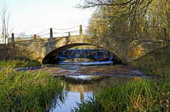 Stanford Hall Old Coach Bridge and Wier Royalty Free Stock Photo