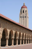 Stanford University Quad and Tower. The arches of the Quad at Stanford University, near Palo Alto, California. Hoover Tower and buildings against blue sky Royalty Free Stock Image