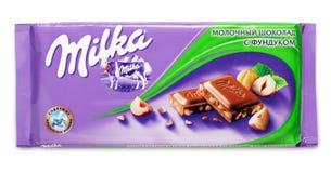 Stange der Milchschokolade Milka mit Haselnuss Lizenzfreie Stockfotos