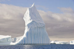 Stange iceberg shape. Materhorn unusual shaped iceberg in Antarctica