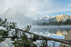 Stanley Lake Idaho with Fog and trees Stock Photo