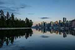 Stanley Park in the evening, Beautiful view of Vancouver. Beautiful view of Vancouver skyline with famous Stanley Park in scenic golden evening light at sunset Royalty Free Stock Photo