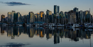 Stanley Park in the evening, Beautiful view of Vancouver. Beautiful view of Vancouver skyline with famous Stanley Park in scenic golden evening light at sunset Stock Image