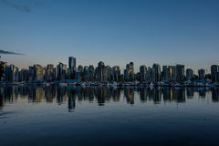 Stanley Park in the evening, Beautiful view of Vancouver. Beautiful view of Vancouver skyline with famous Stanley Park in scenic golden evening light at sunset Stock Photo