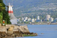 Prospect Point Lighthouse and North Vancouver, Canada. Stanley Park`s landmark Prospect Point Lighthouse with north Vancouver across the inlet stock image