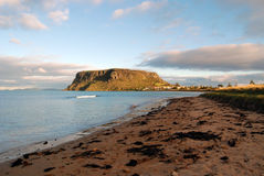Stanley, Tasmania. The historic village of Stanley in north-west Tasmania is nestled at the base of a sheer-sided bluff called 'The Nut'. It is the remnant of an Royalty Free Stock Photo