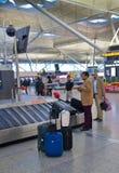 Stansted flygplats, väntande område för bagage Arkivbild