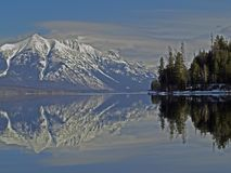 Stanton Mountain Reflected in Lake McDonald. This picture shows Stanton Mountains and its reflection in Lake McDonald during the early spring Stock Image