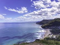 Stanwell Park beach at Wollongong, Australia. This picture was taken at Stanwell Park Beach, Wollongong, Australia. Taken from a cliff, the beach, mountains as stock image