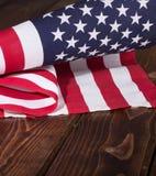 Stany Zjednoczone flaga na Nieociosanym Drewnianym tle Zdjęcie Stock